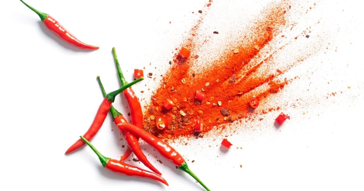 Cayenne peppers spread out on a table