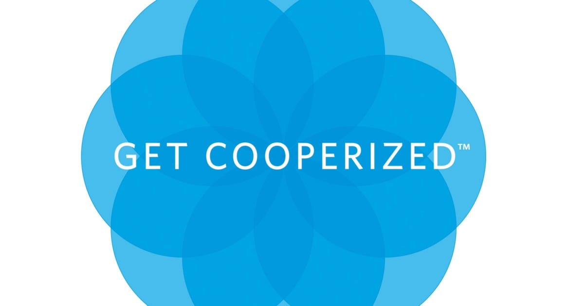 Graphic image of Cooper Aerobics Get Cooperized image of eight blue circles making up the petals of a flower
