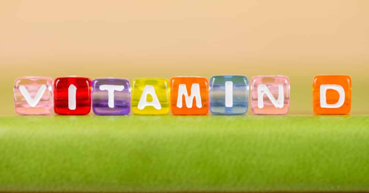 Vitamins spelled out with colored cubes