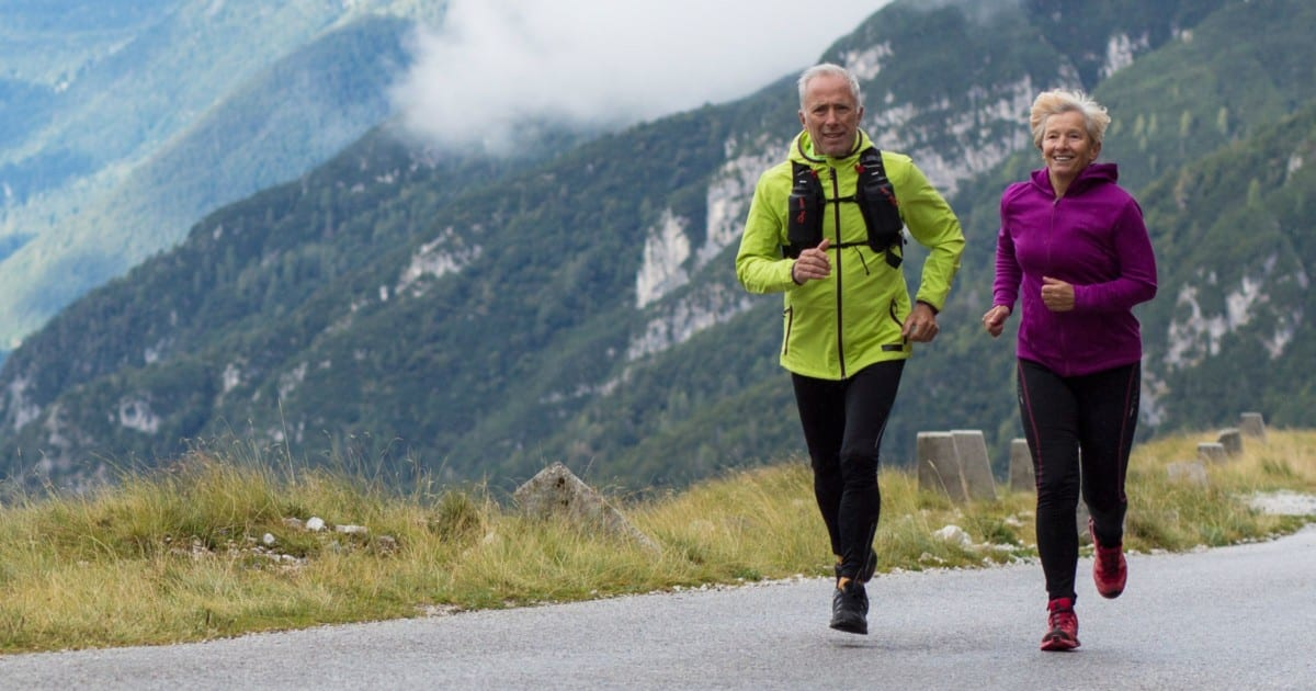 Photo of an older man jogging in the mountains. Compare Centrum vitamins to Cooper Complete Nutritional Supplements