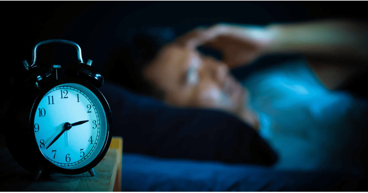 person trying to get sleep using sleep supplements