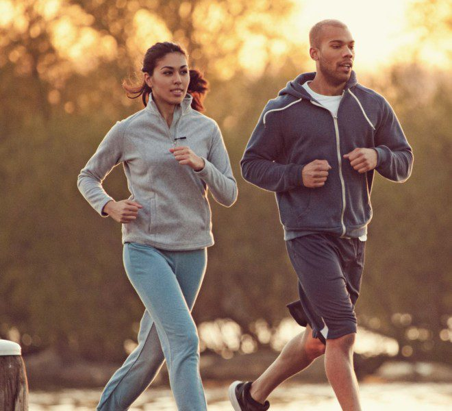 Two people jogging and enjoying a run outside