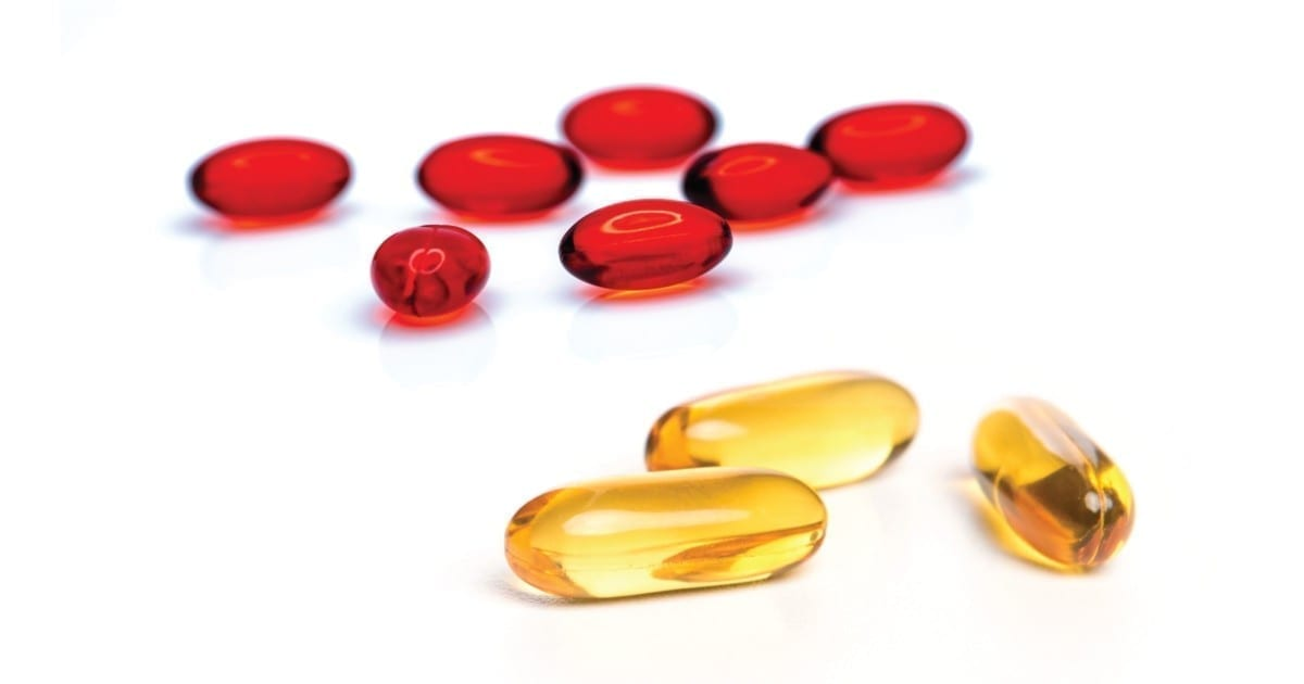 Omega-3 fish oil vs krill oil differences shown on a table beside each other
